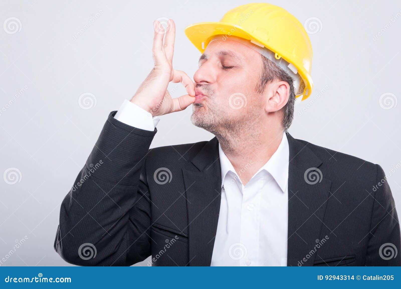 Portrait of handsome engineer making perfect gesture