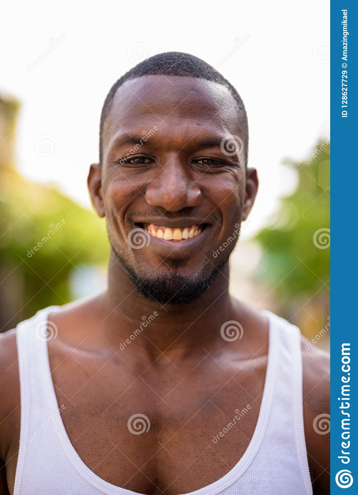 d46054e05 Portrait of handsome muscular African man wearing tank top in the streets  outdoors