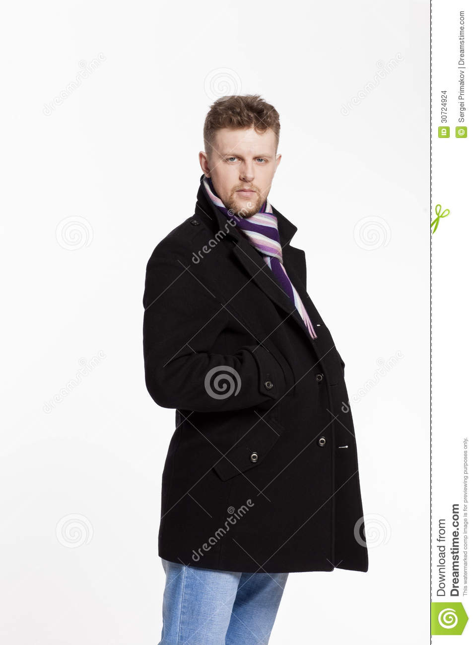 Portrait of handsome stylish blond man in sunglasses and a coat