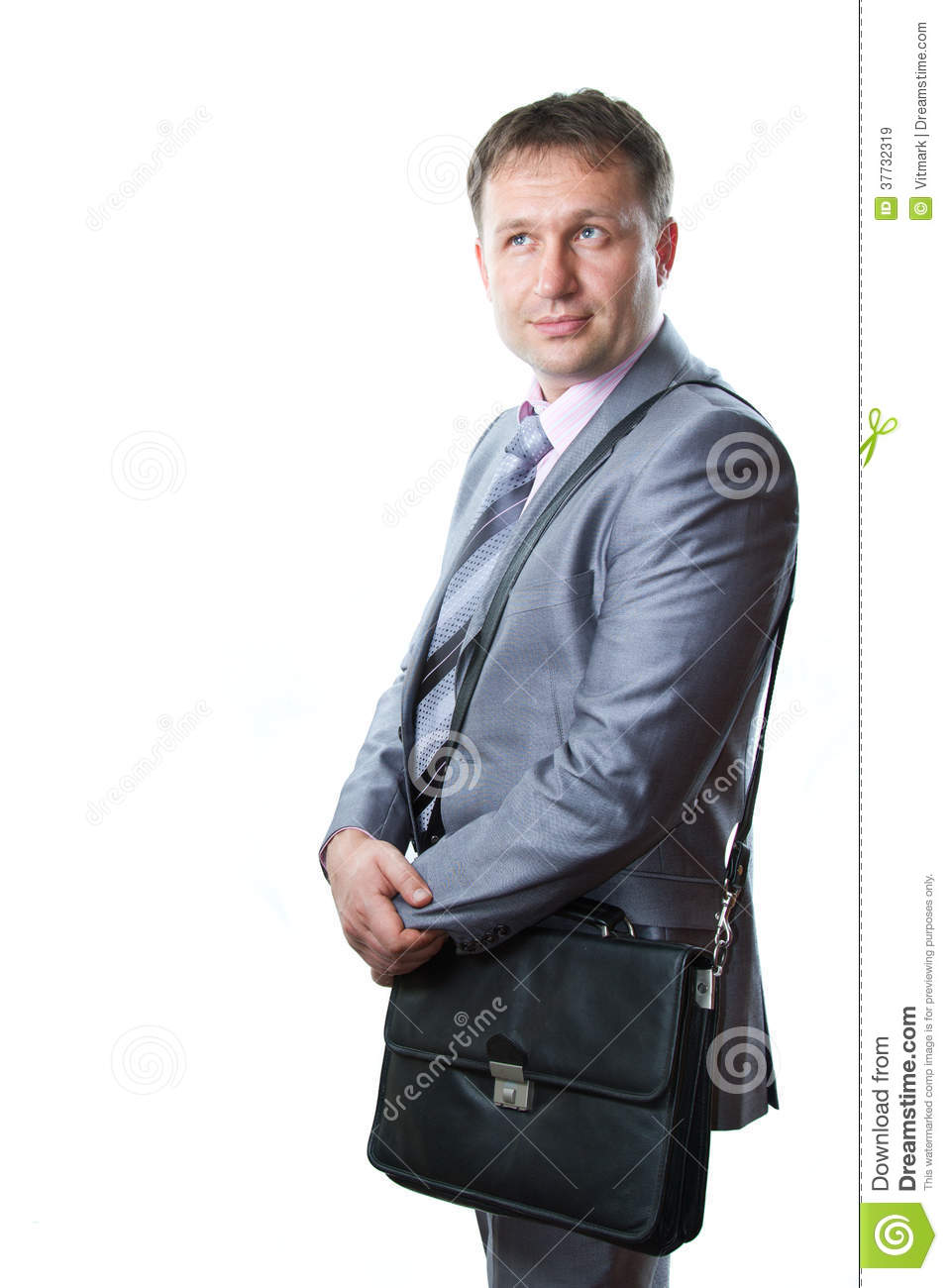 Portrait of a handsome young businessman with bag in suit isolated