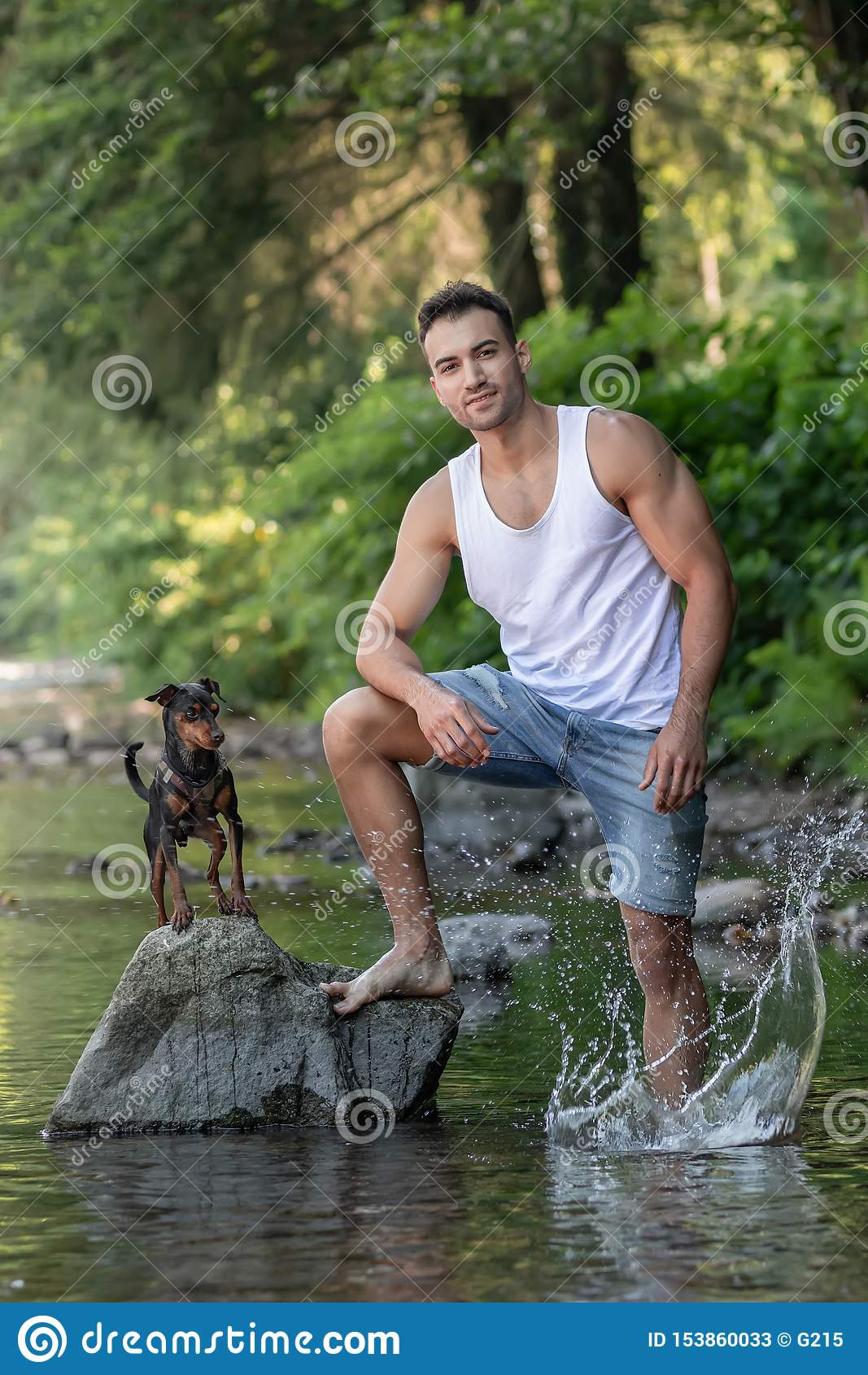 Portrait of handsome young man with dog, outdoor