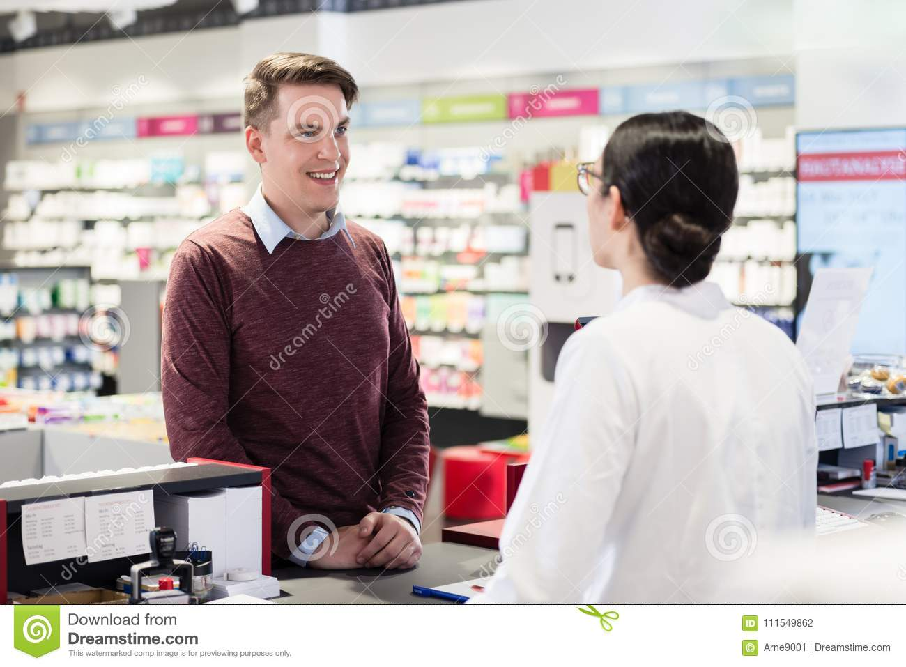 Happy customer listening to the recommendations of a reliable pharmacist