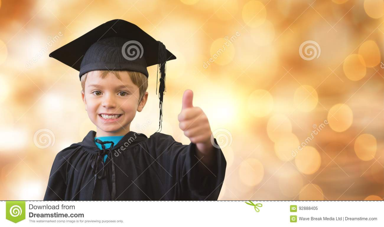 Portrait Of Happy Boy In Graduation Gown And Mortar Board Showing ...