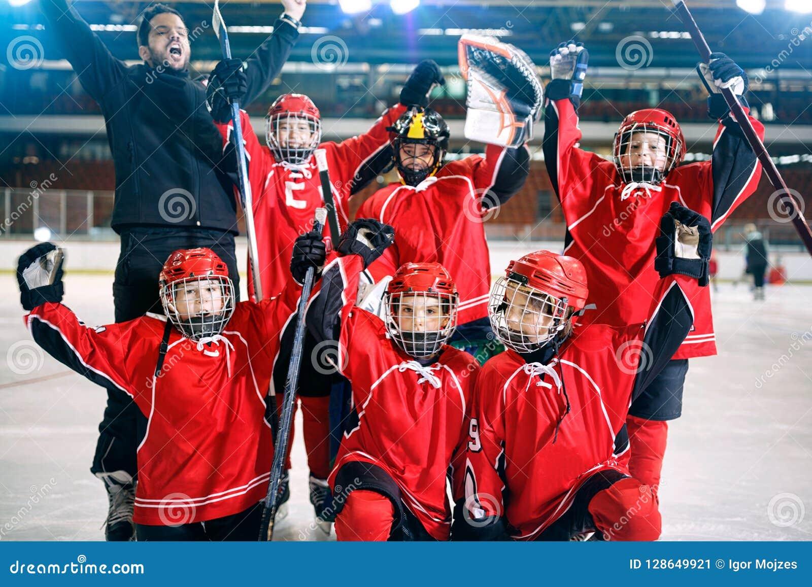 Portrait of happy boys players team ice hockey