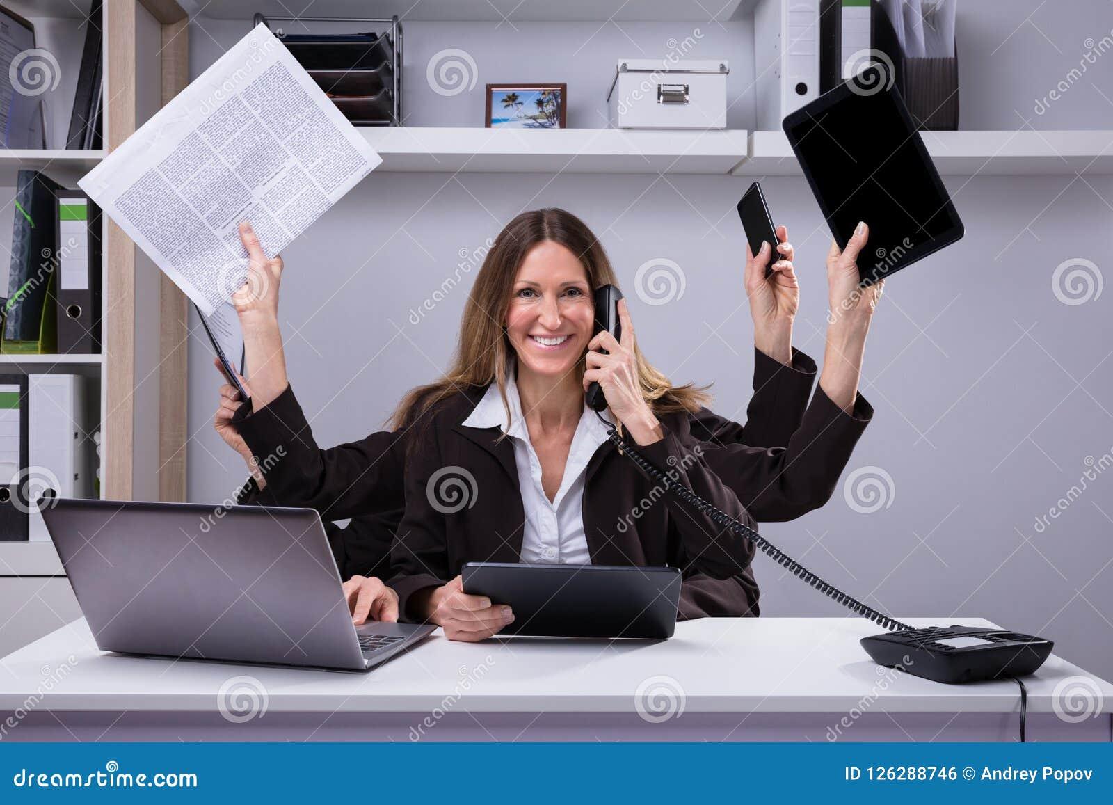 Businesswoman Doing Multitasking Work In Office Stock ...