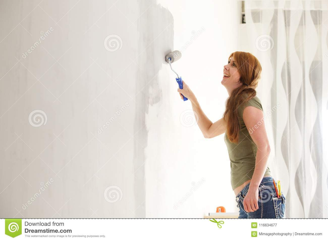 Girl Painting A Wall Royalty Free Stock Image   Stock
