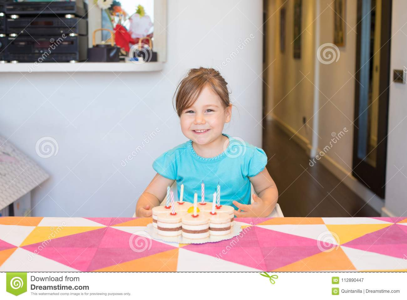 Portrait of happy child with birthday cake