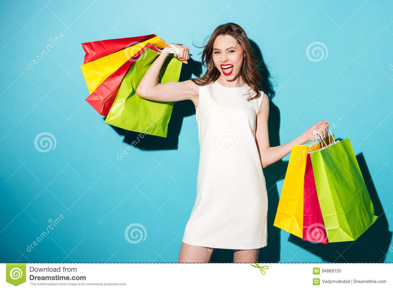 5697a32a198cd Portrait Of A Happy Excited Girl Holding Colorful Shopping Bags ...