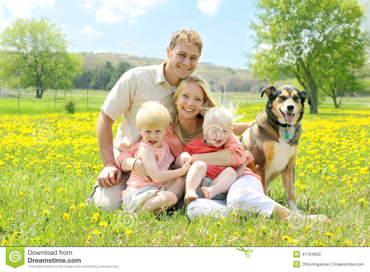 Download Portrait Of Happy Family And Dog In Flower Meadow Stock Image