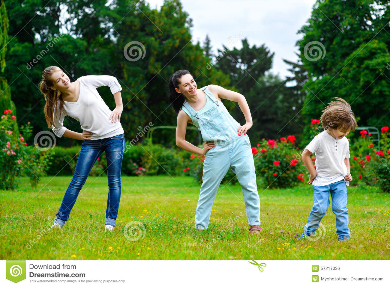 Portrait of happy family doing physical exercise