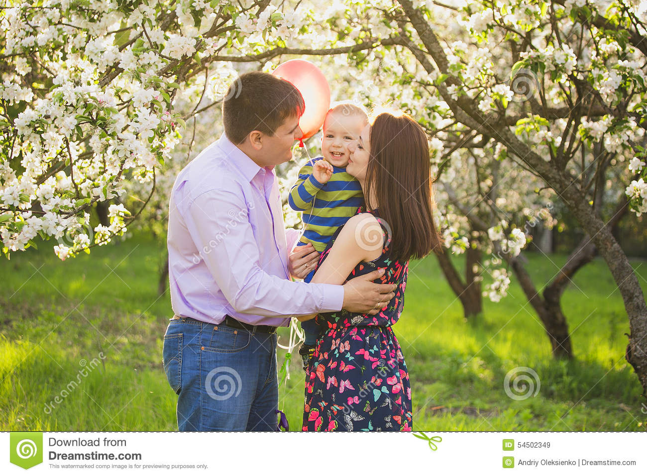 Portrait of happy family. father, mother, child hugging and kiss