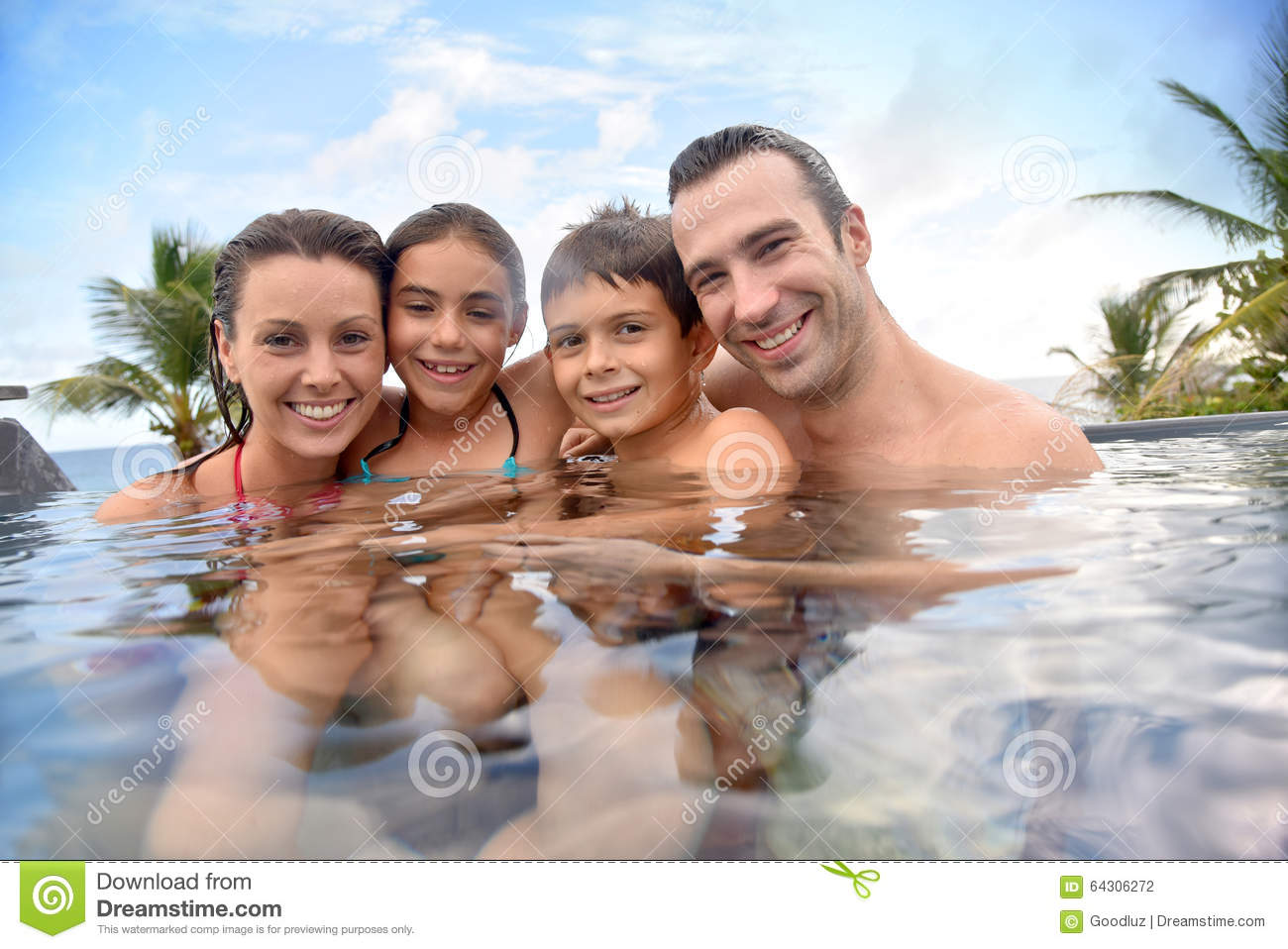 Portrait of happy family on summer holidays in tropics