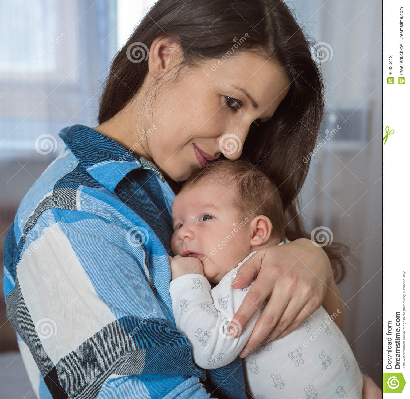 Portrait of a happy family. A woman with a newborn baby