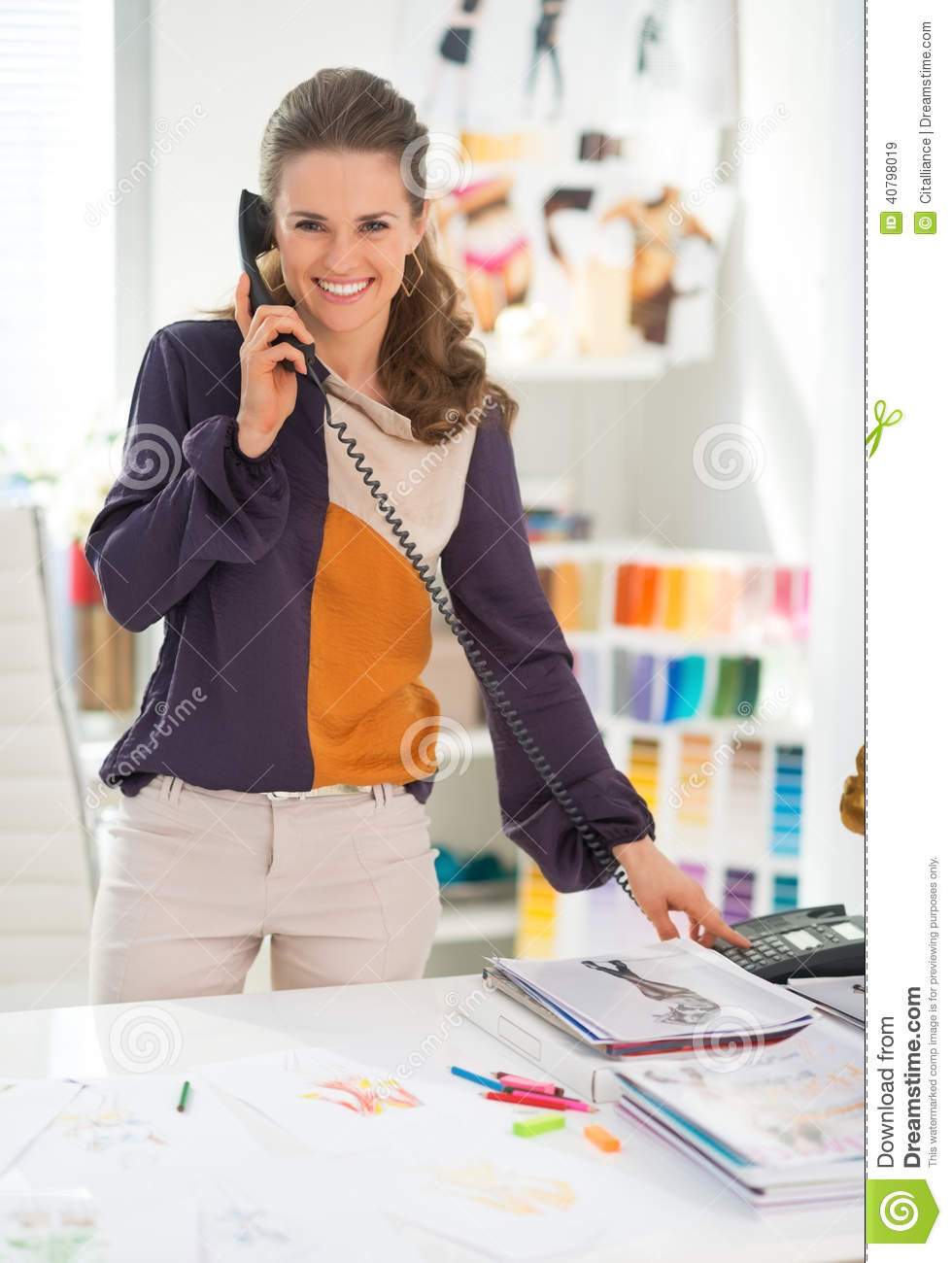 Portrait of happy fashion designer with phone stock photo Office designer online