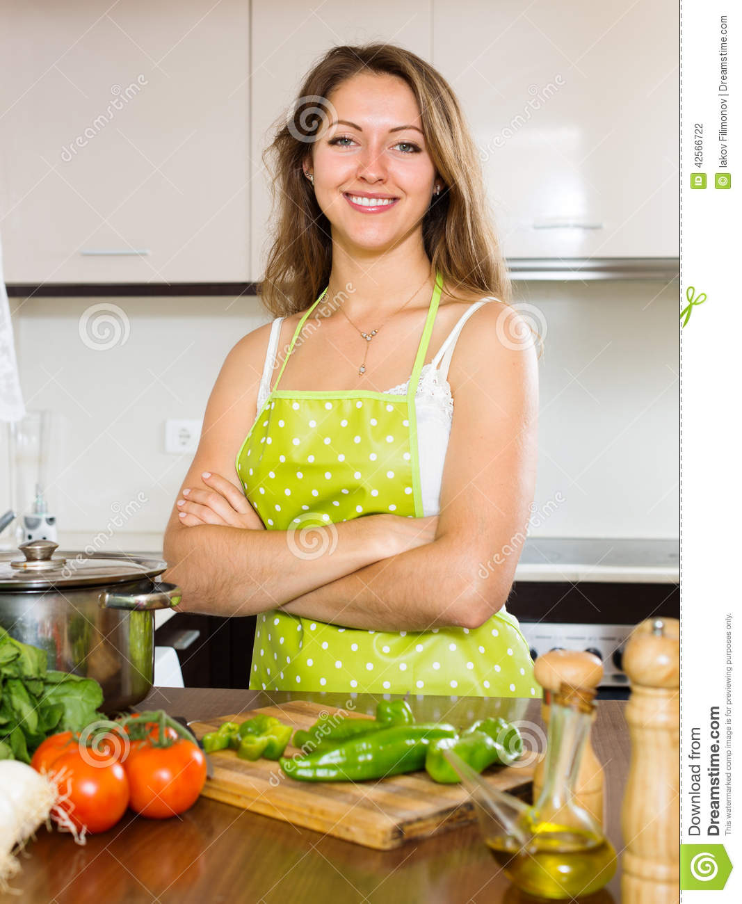 Portrait Of Happy Girl Cooking At Kitchen Stock Photo