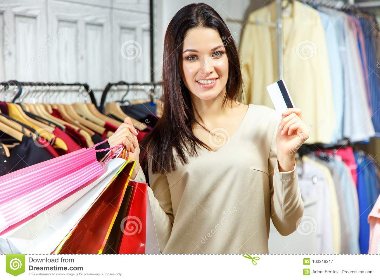 Portrait Of A Happy Girl With Shopping Bags And Credit Card In A