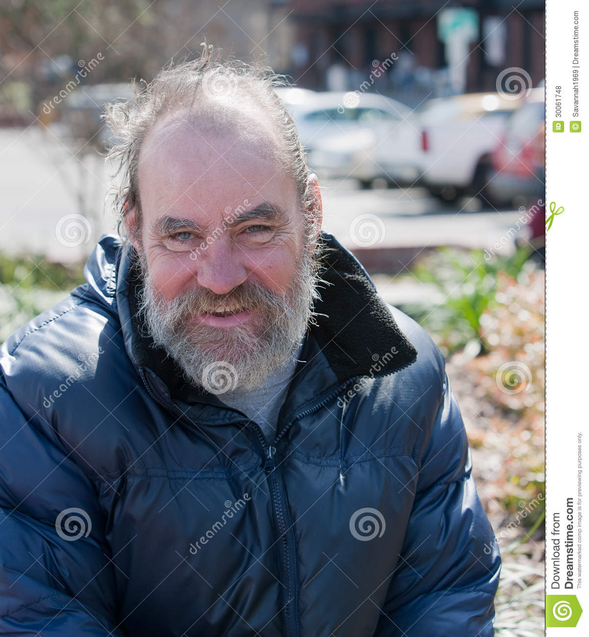 Portrait of happy homeless man outdoors during the day Happy Homeless Man