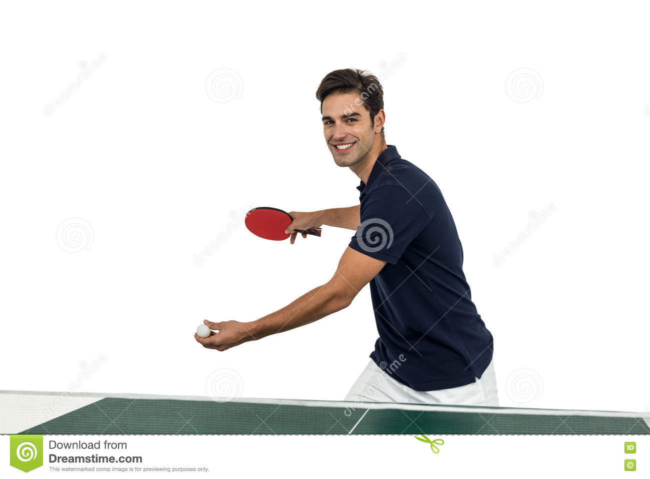 Portrait of happy male athlete playing table tennis