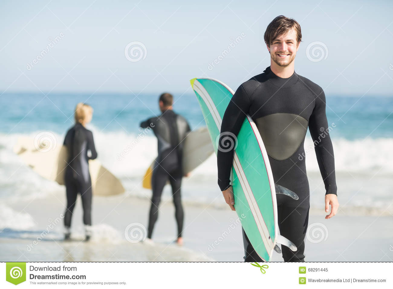 Portrait Of Happy Man Holding A Surfboard On The Beach Stock Image ... 7c8688529