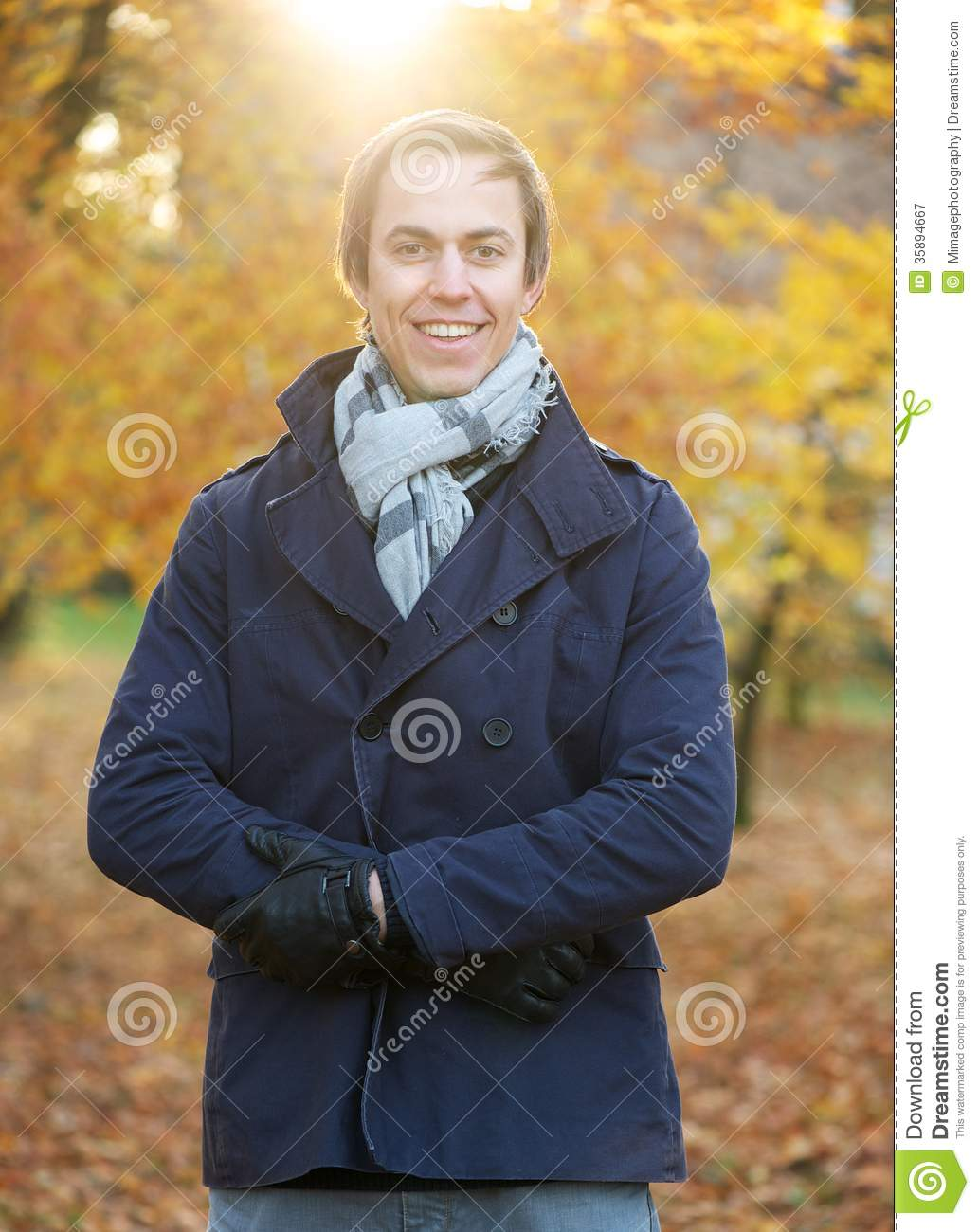 Portrait of a happy man standing outside on a fall day