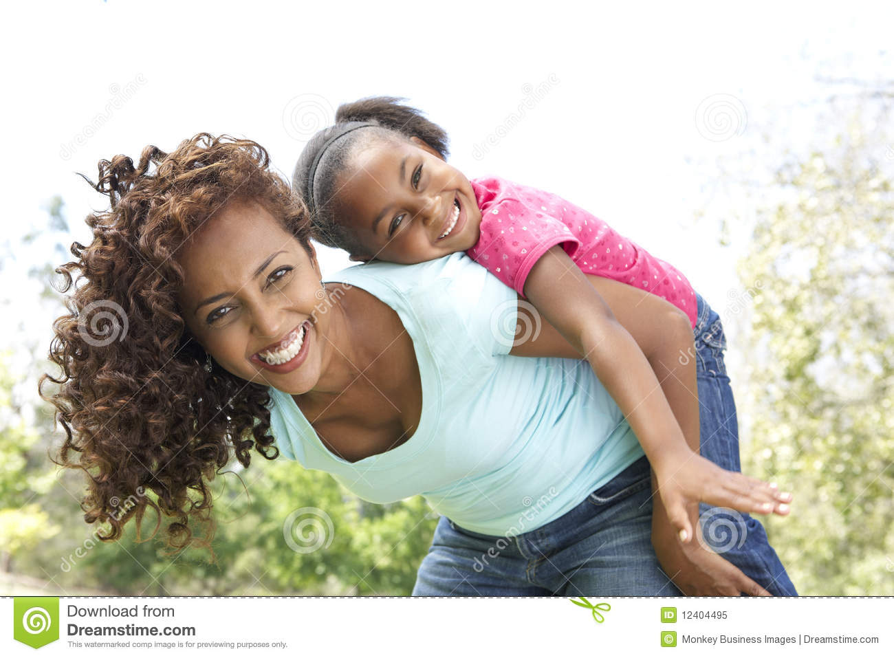 Portrait of Happy Mother and Daughter In Park