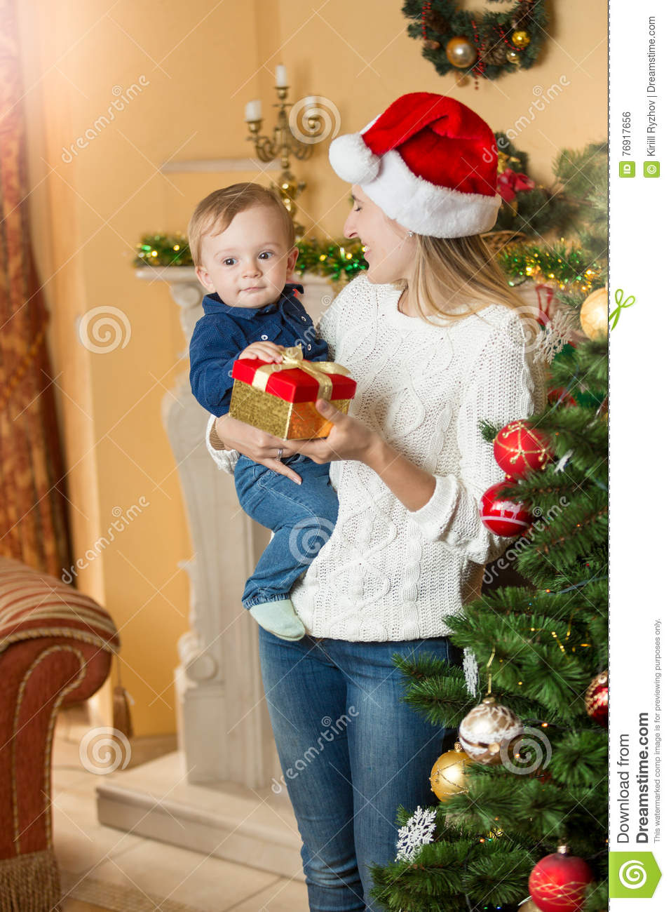 portrait of happy mother giving present to her baby son on chris
