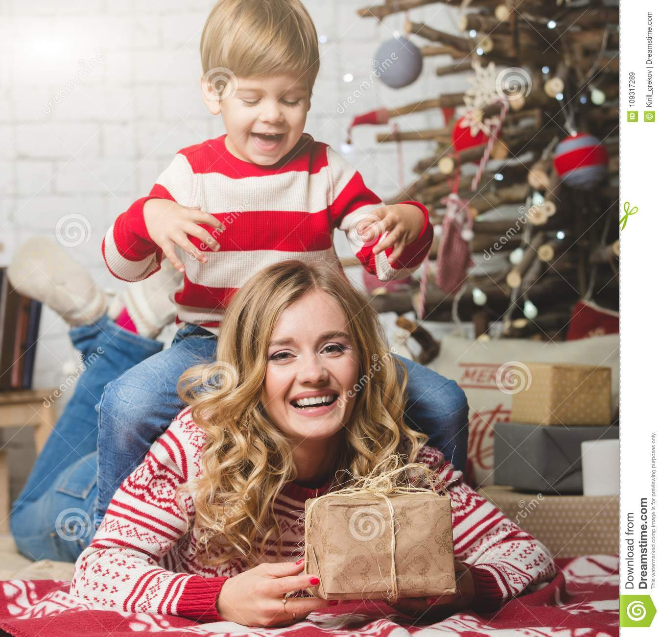 Portrait Of Happy Mother And Son On The Background Of The Christmas Tree In New Year Room The Idea For Postcards Stock Image Image Of Female Birthday 109317289