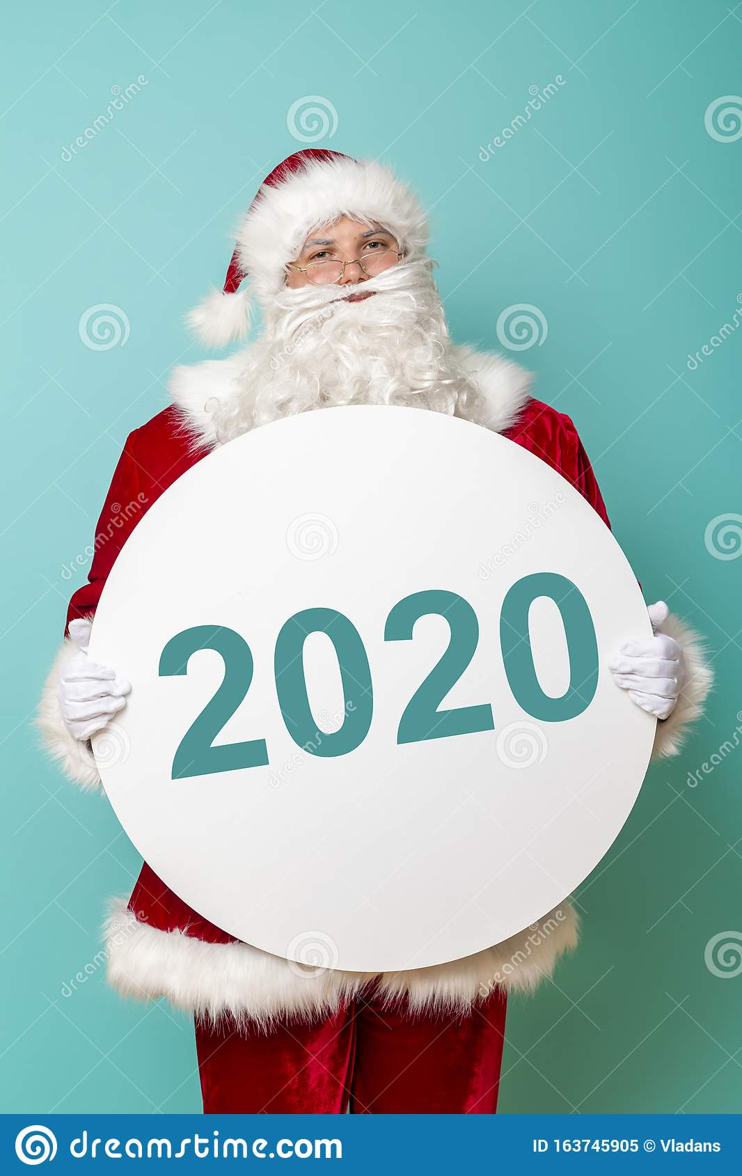 2020 Christmas Sales Numbers Santa Holding Cardboard Circle With Numbers 2020 Stock Image