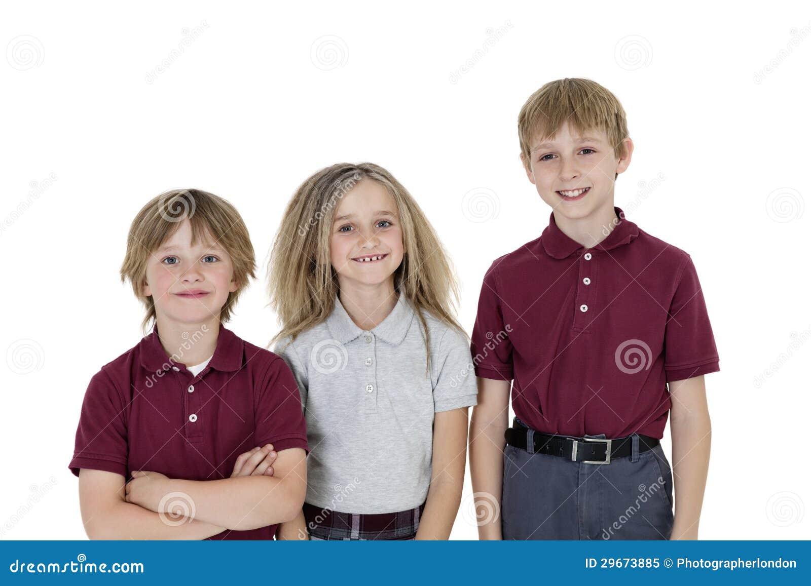 Portrait Of Happy School Children In Uniform Over White ...