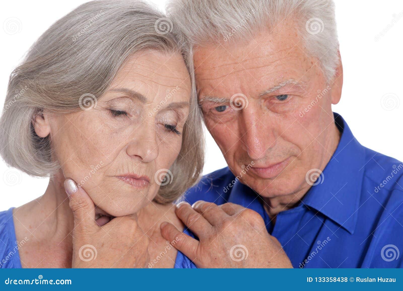 Portrait of a happy senior couple on white background
