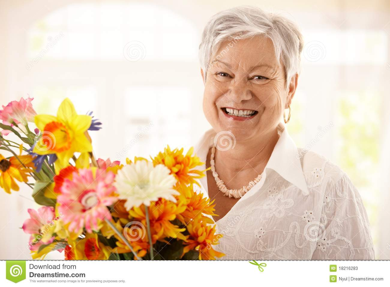 Portrait Of Happy Senior Woman Holding Flowers Stock Image ...