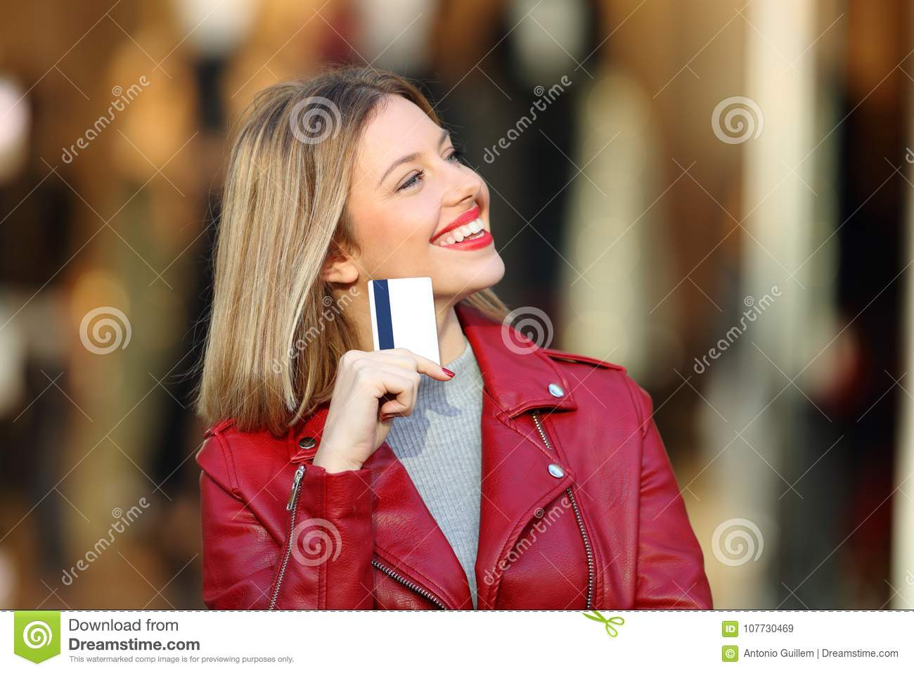 Shopper wondering what to buy holding a credit card
