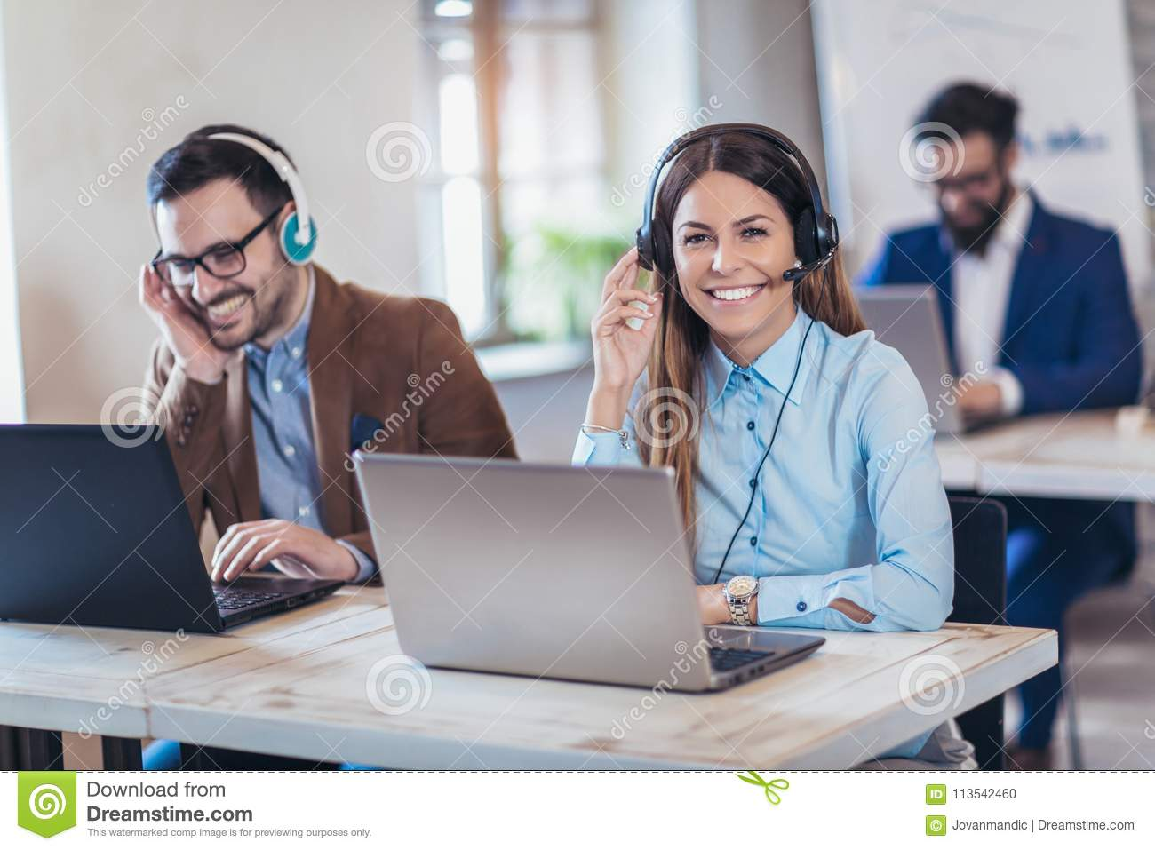 Portrait of happy smiling female customer support phone operator