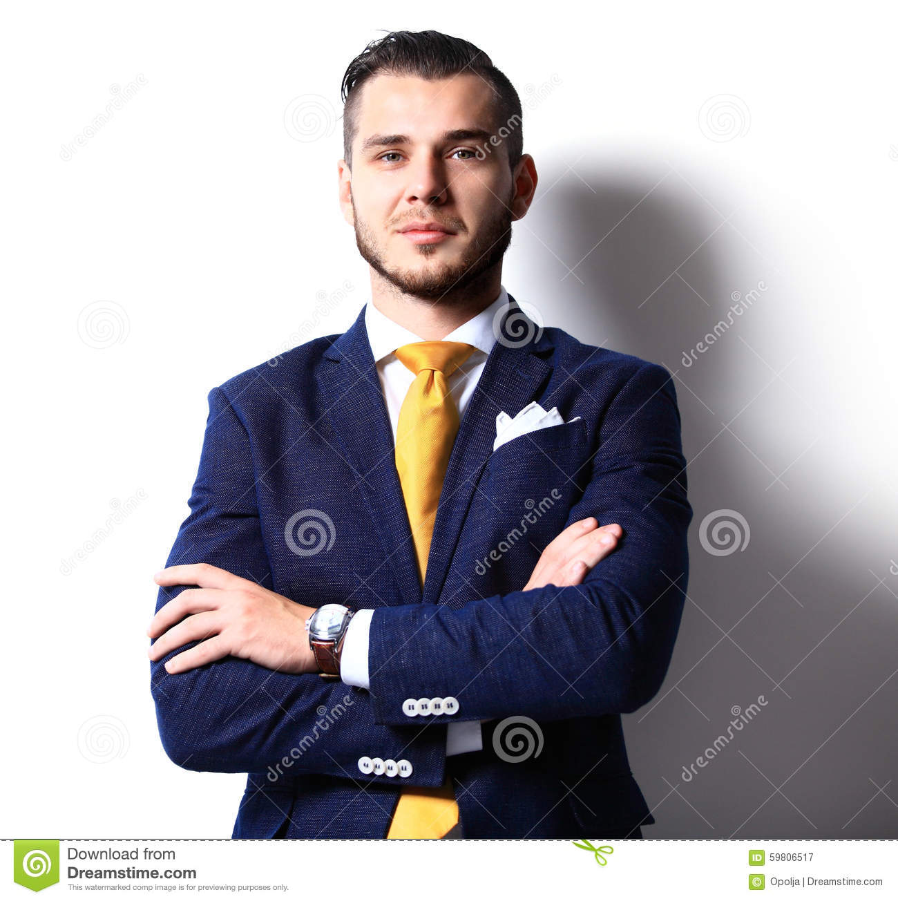 Portrait of happy smiling young businessman