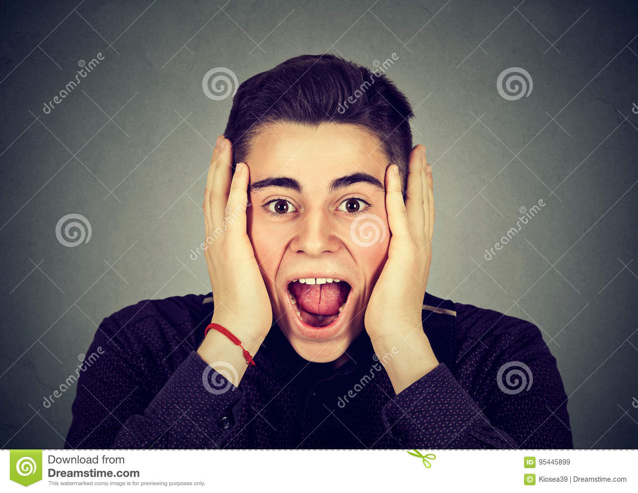 Portrait of a happy surprised man screaming