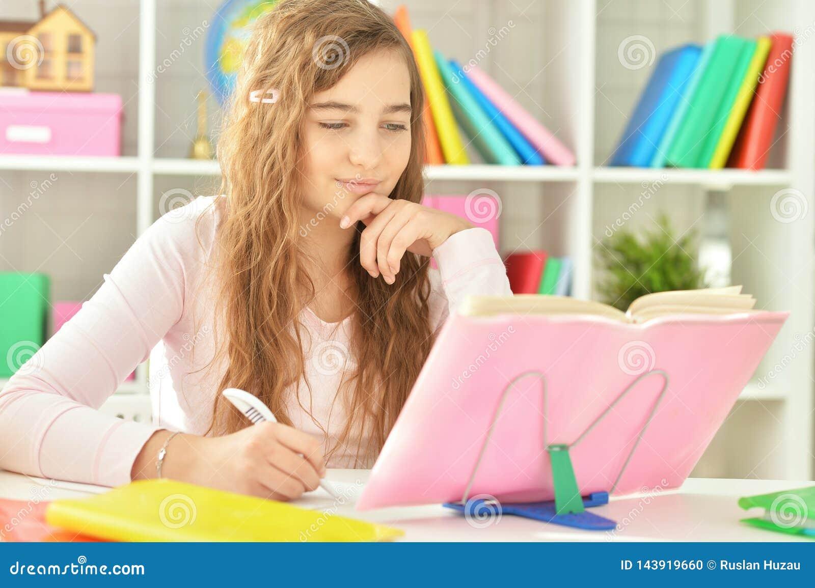 Young Teenager Girl Working On Her Homework Stock Photo