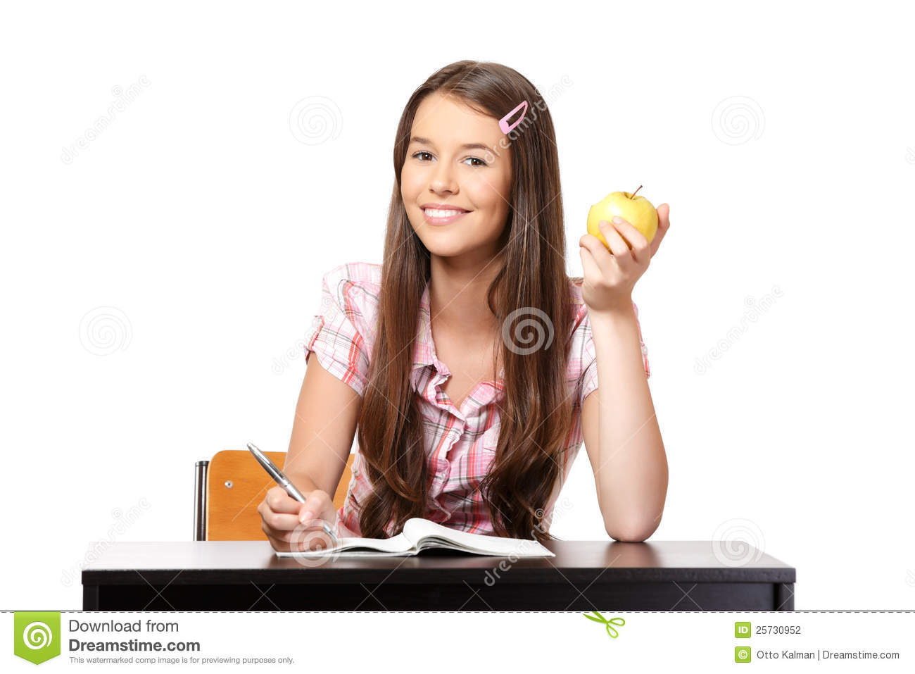Portrait of a happy teenager with apple