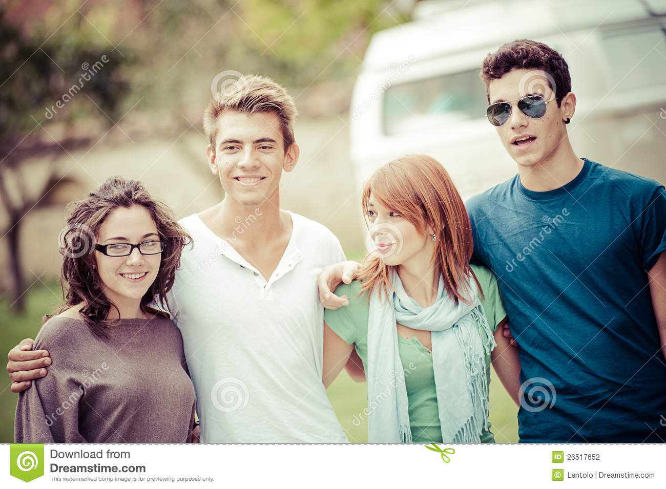 Portrait of happy teens in the park at summer