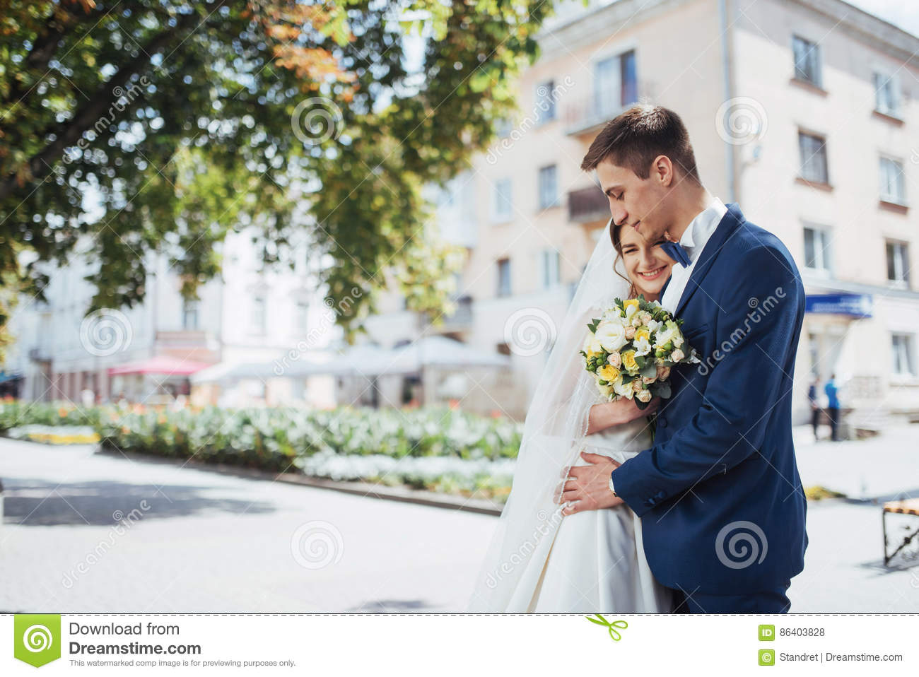 Portrait of happy wedding couple outdoors. Fantastic summer day