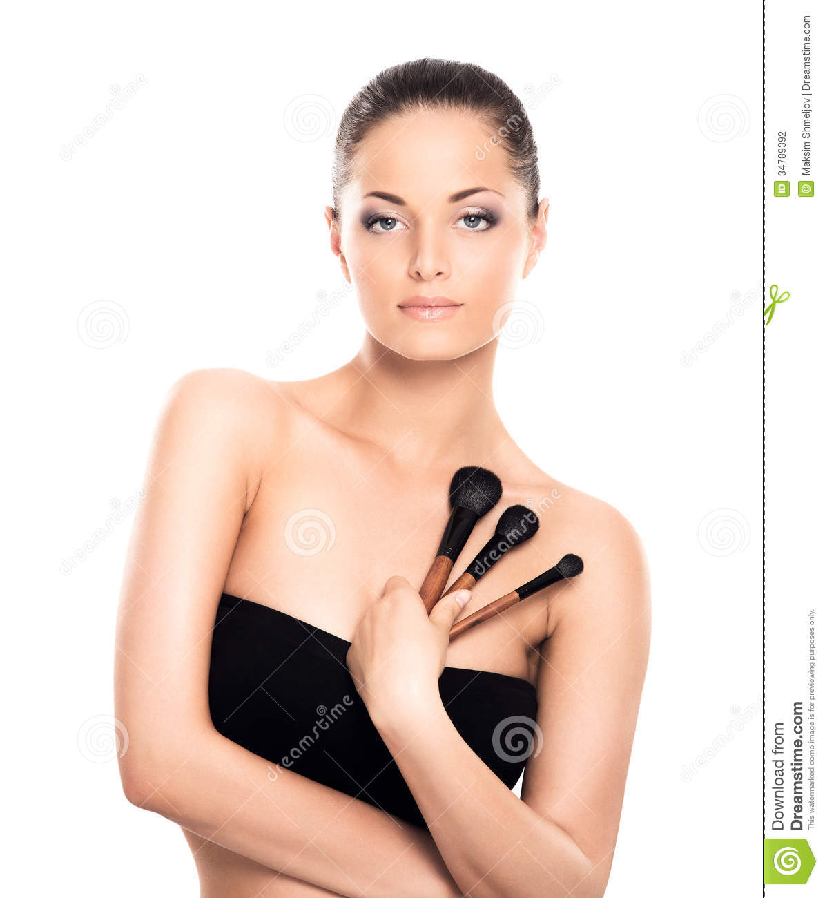 Beauty Holding It: Portrait Of A Happy Woman Holding Makeup Brushes Stock