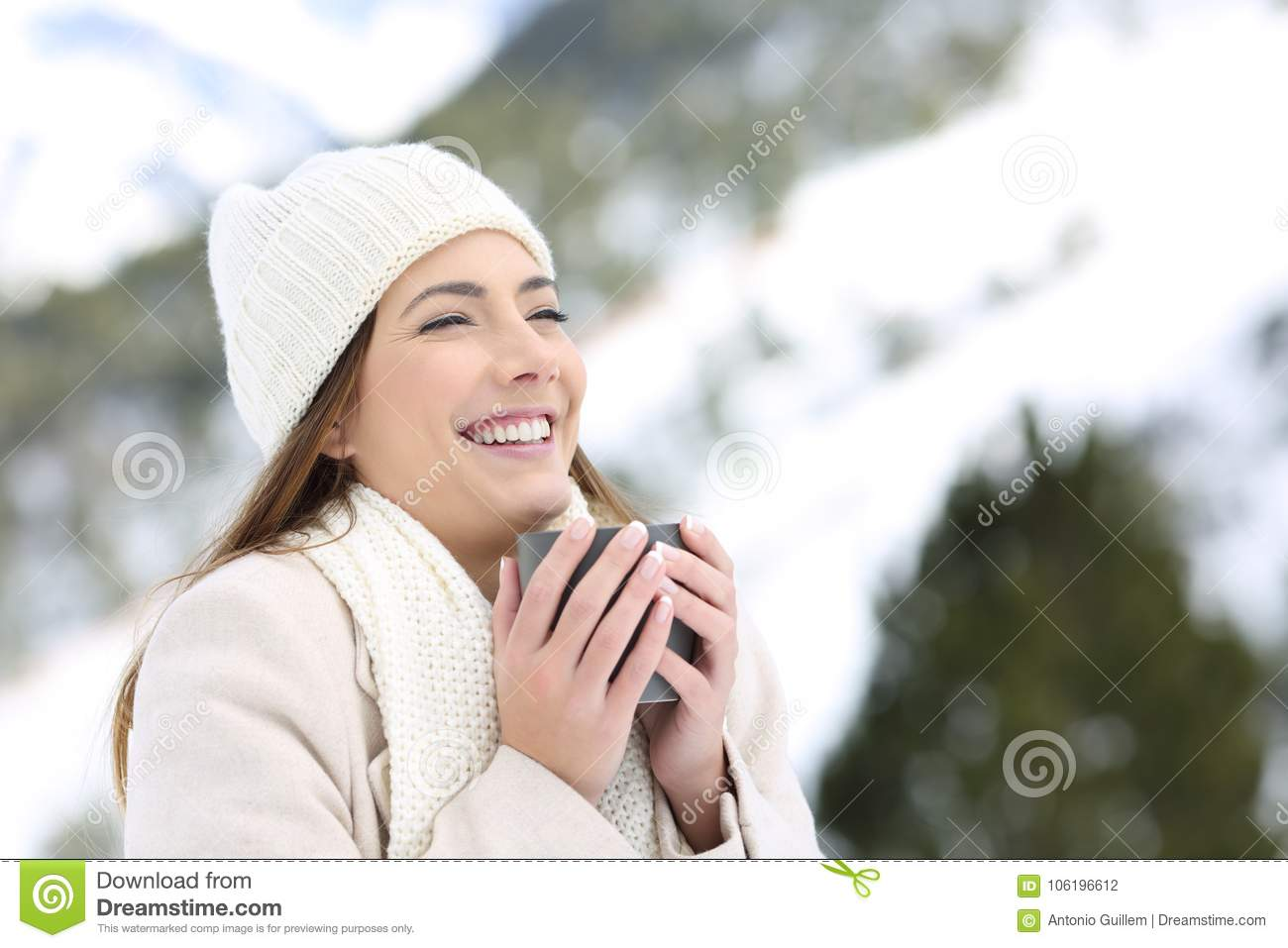 52f181b67aab Woman Keeping Warm Holding A Cup Of Coffee In Winter Stock Photo ...
