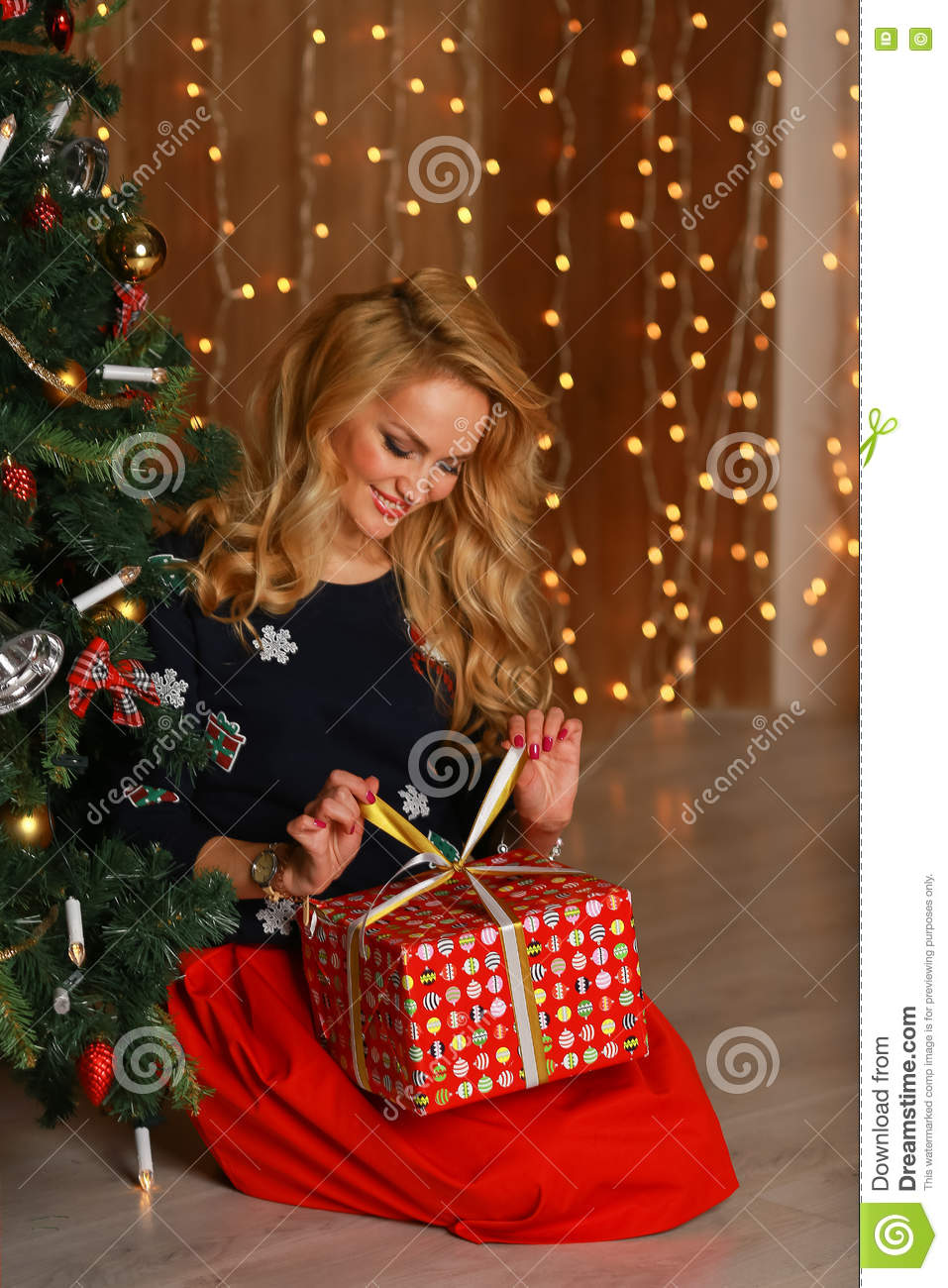 Portrait Of A Happy Woman Smiling And Opening Gift Box ...