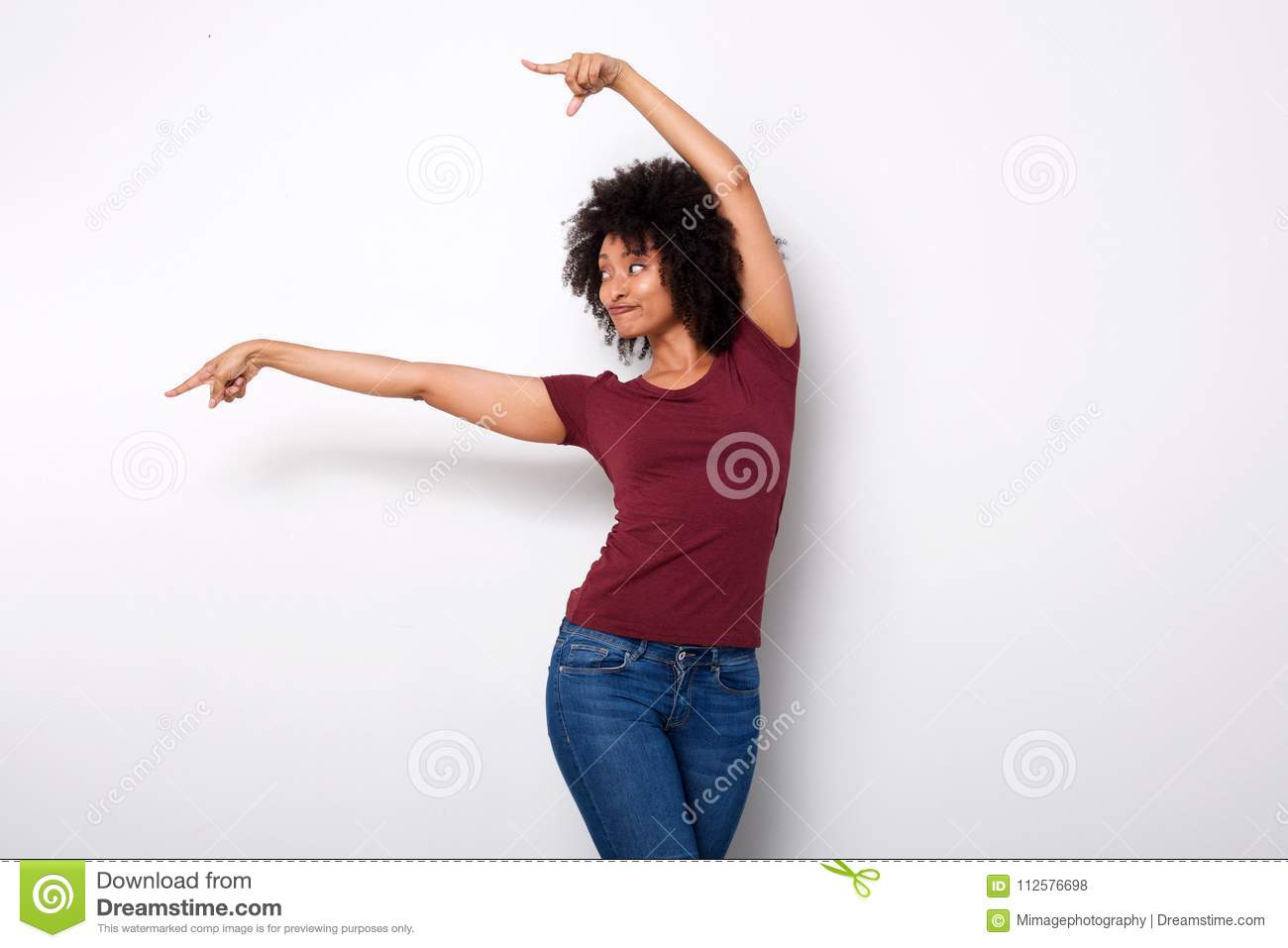 Happy young african american woman pointing at side with both hands on white background