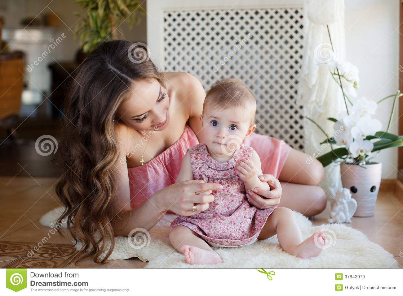 f710d15edee2 Portrait Of Happy Young Attractive Mother Playing With Her Baby Girl ...