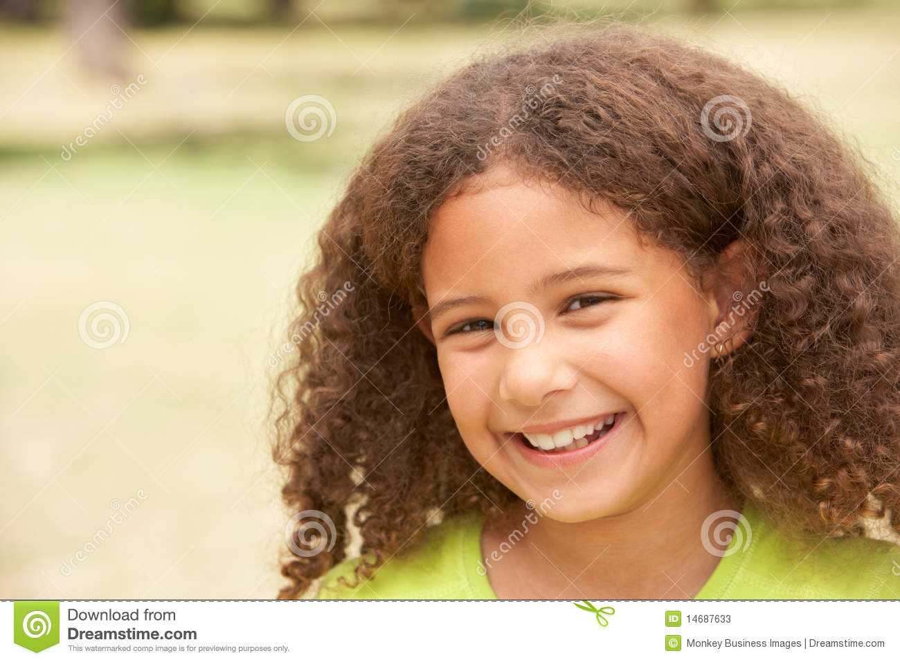 Portrait Of Happy Young Girl In Park