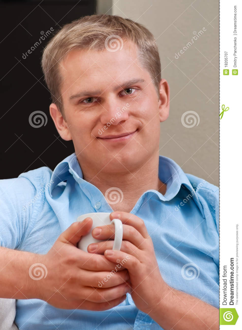 Portrait of a happy young man with cup
