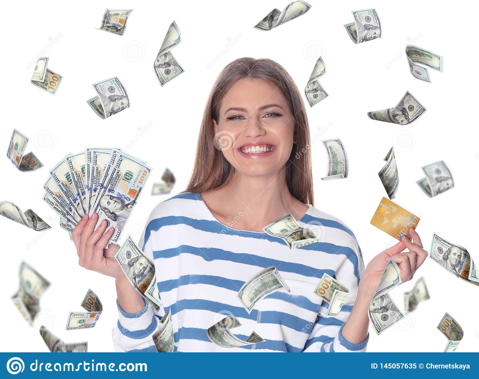 Portrait of happy young woman with money and credit card