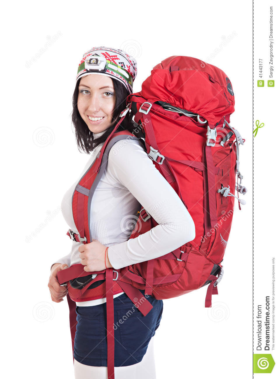 Portrait of hiker woman with backpack isolated on white backgrou