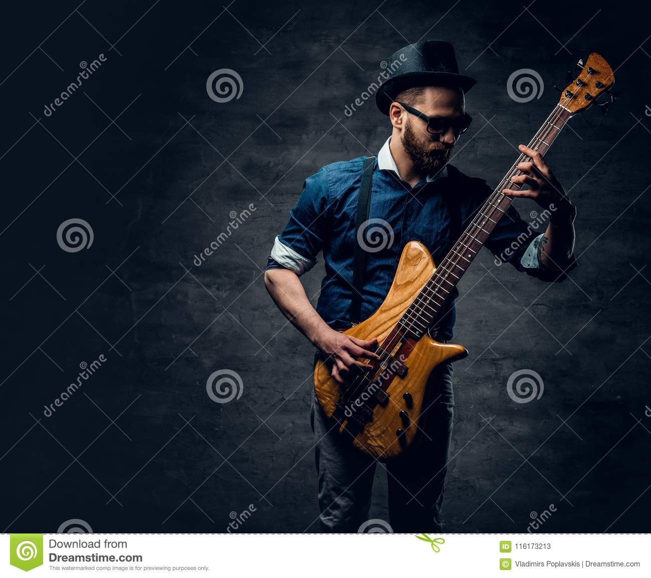 Portrait of the hipster bass player dressed in cylinder hat.