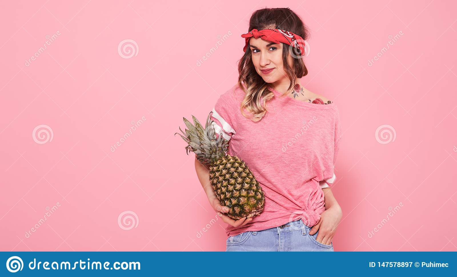 Portrait of hipster girl and pineapple isolated on pink background